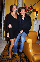 MR & MRS SEB BISHOP she was model Heidi Wichlinski former girlfriend of racing driver David Coulthard at a party to celebrate the launch of Michelle Watches held at the Blue Bar, The Berkeley Hotel, London on 7th October 2004.<br /><br />NON EXCLUSIVE - WORLD RIGHTS