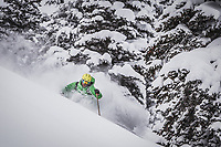 Rob Lea skiing deep powder in the Wasatch Mountains.