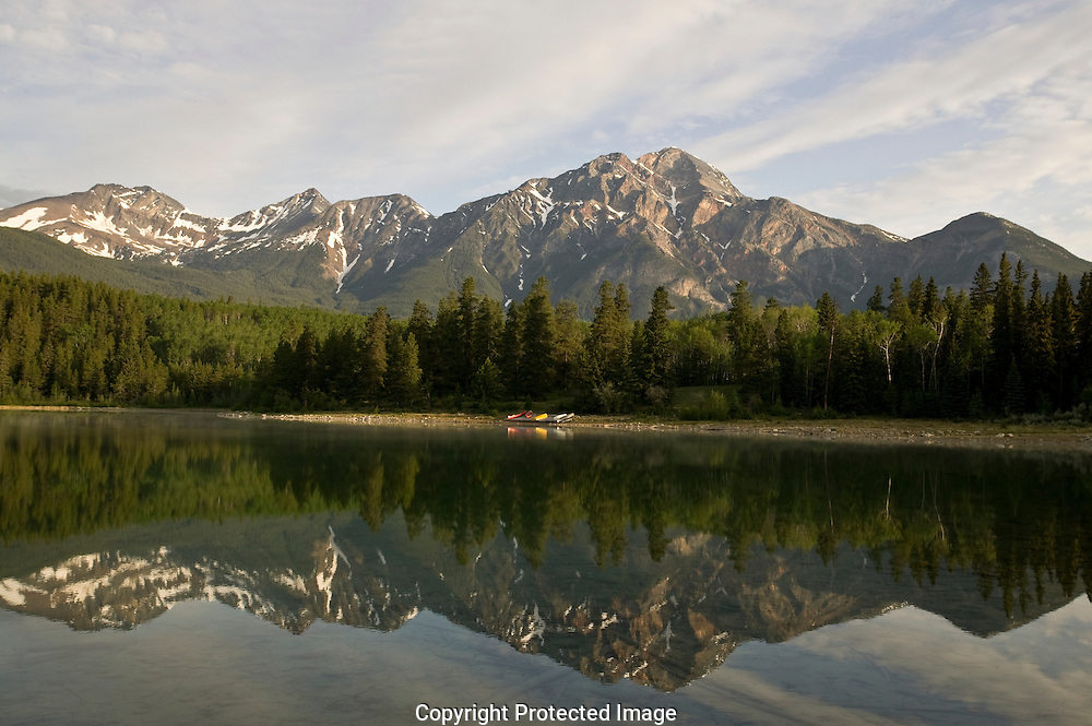 Photo Randy Vanderveen.Pyramid Mountain is reflected in the lake of the same name in the early morning in Jasper National Park.