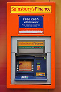 A Sainsburys bank cash machine, outside a supermarket. London.