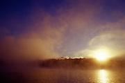 Foggy, cold sunrise over lake - Quebec, Canada