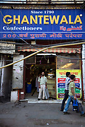 Raj who delivers the sweets in the Ghantewallah Confectionary shop on Chadni Chowk. The shop has stood here since 1790. Delhi, India