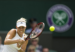 LONDON, July 5, 2017  Angelique Kerber of Germany hits a return during the women's singles first round match against Irina Falconi of the United States at the Championship Wimbledon 2017 in London, Britain, on July 4, 2017. Kerber won 2-0. (Credit Image: © Jin Yu/Xinhua via ZUMA Wire)