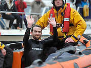 Putney- Mortlake, LONDON, GREAT BRITAIN,   The protester is ferried by the RNLI from the umpires launch to  Chiswick Pier,  during the the 2012 Boat Race Oxford University vs Cambridge University. Raced over the championship course. Putney/Mortlake, Saturday  07/04/2012  [Mandatory Credit, Peter Spurrier/Intersport-images]