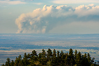 As I was driving down Red Grade Road, I noticed this smoke plume in the distance. The fire seemed very active, forming pyrocumulus clouds above. But I never found out any info on the fire. It was somewhere in Montana on the Northern Cheyenne Indian Reservation.