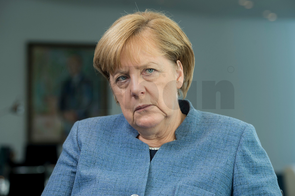 09 OCT 2017, BERLIN/GERMANY:<br /> Angela Merkel, CDU, Bundeskanzlerin, waehrend einem Interview, in ihrem Buero, Bundeskanzleramt<br /> IMAGE: 20171009-01-009<br /> KEYWORDS: Büro