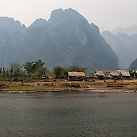 """According to """"Wikipedia"""" - The Nam Song River is a small river in Laos that flows through the town of Vang Vieng. It is a popular tourist destination as many people enjoy seeing the Laotian countryside while going down the river in the inner tube of a tractor tyre or in a kayak. The river is surrounded by striking karst rock formations."""