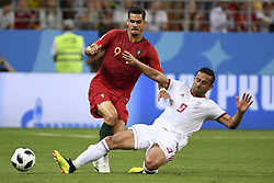 June 25, 2018 - Saransk, Russia - Andre Silva of Portugal and Omid Ebrahimi of Iran during the 2018 FIFA World Cup Group B match between Iran and Portugal at Mordovia Arena in Saransk, Russia on June 25, 2018  (Credit Image: © Andrew Surma/NurPhoto via ZUMA Press)
