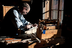 Craftsman carpenter making furniture at Skansen open air museum in Stockholm Sweden 2009