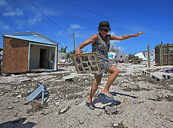 Laura Costello avoids tripping on a rock where her trailer once stood at the Seabreeze trailer park along the Overseas Highway in the Florida Keys on Tuesday, September 12, 2017. Photo by Al Diaz/Miami Herald/TNS/ABACAPRESS.COM