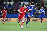 Aron Gunnarsson of Cardiff takes the ball past Tyrone Mings of Ipswich.<br /> <br /> Skybet Football League Championship match, Cardiff City v Ipswich Town at the Cardiff city stadium in Cardiff, South Wales on Tuesday 21st October 2014<br /> pic by Mark Hawkins, Andrew Orchard sports photography.