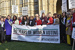 February 6, 2018 - London, UK - LONDON, UK.  Female members of the Shadow Cabinet and Labour politicians stand outside the Houses of Parliament, wearing Labour styled suffragette rosettes, hold placards next to a '100 Years of Women Voting' banner help launch Labour's campaign to celebrate 100 years of women's suffrage. (Credit Image: © Stephen Chung/London News Pictures via ZUMA Wire)