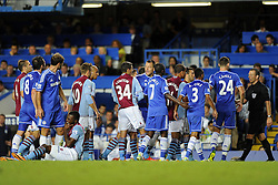 "Aston Villa and Chelsea players surround the referee as Aston Villa's Christian Benteke lies injured  - Photo mandatory by-line: Joe Meredith/JMP - Tel: Mobile: 07966 386802 21/08/2013 - SPORT - FOOTBALL - Stamford Bridge - London - Chelsea V Aston Villa - Barclays Premier League - EDITORIAL USE ONLY. No use with unauthorised audio, video, data, fixture lists, club/league logos or ""live"" services. Online in-match use limited to 45 images, no video emulation. No use in betting, games or single club/league/player publications"