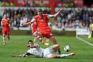 Southampton 's Sam Gallagher is tackled by Swansea's Jordi Amat .Barclays Premier league match, Swansea city v Southampton at the Liberty stadium in Swansea, South Wales on Saturday 3rd May 2014.<br /> pic by Andrew Orchard, Andrew Orchard sports photography.