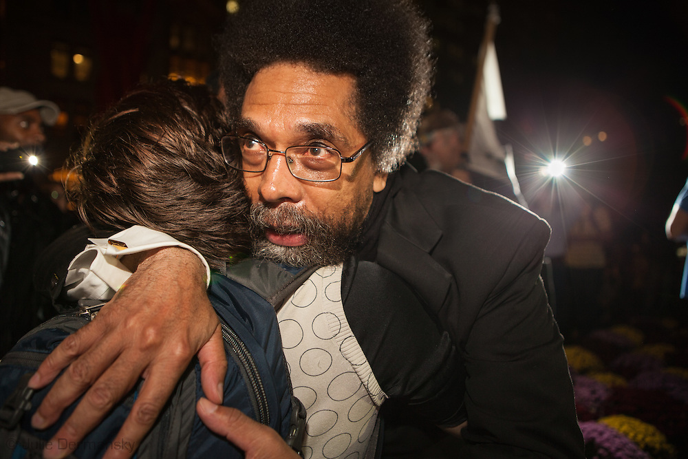 New York City, NY, Sept 27th 2011, Cornel West , philosopher, author, critic, intellectual, civil rights activist and Professor at Princeton University hugs a fan after speaking to a crowd of close to 2000 at the Occupy Wall Street protest in Zuccotti Park  ( also know as Liberty Square) .