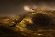 """SUN28 Shot Up North Awards winning entry (2016).<br /> <br /> International Color Awards 2016 - Nominee in """"Nature"""" category<br /> <br /> The huge & imposing massif of Yr Wyddfa (Snowdon) Wales' highest mountain. This was taken following a last minute decision to slog up Mynydd Mawr under inclement weather but it resulted in just the most fantastic hour of weather-watching from it's summit. I was utterly gripped by the continual theatrical change of light being played out across the Snowdonia hills."""