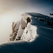 Trey Scharp and Jess McMillan hike the ridge towards Cody Peak in the backcountry near Jackson Hole Mountain Resort, Wyoming.