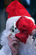 Moscow, Russia, 06/01/2006..Russians celebrate the lengthy New Year and Orthodox Christmas holidays. Street photographer dressed as Ded Moroz [Father Frost] , the Russian version of Santa Claus.