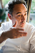 Ferran Adrià, a chef at the famous El Bulli restaurant near Rosas on the Costa Brava in Northern Spain, speaks to a colleague.  (Ferran Adrià is featured in the book What I Eat: Around the World in 80 Diets.) MODEL RELEASED.