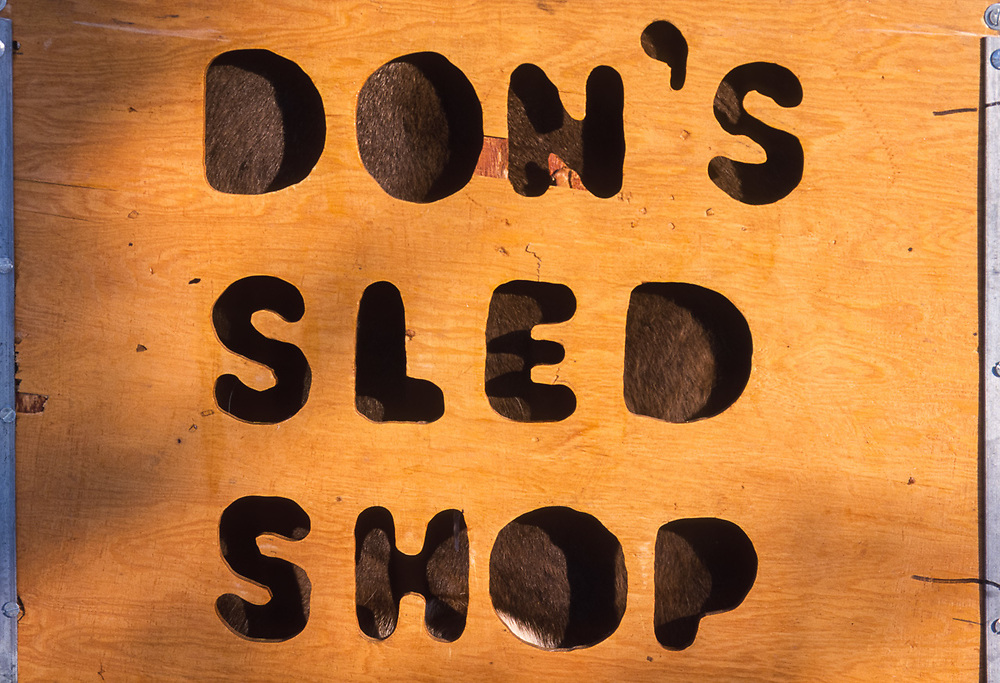 Don's Sled Shop sign, Kiana, Alaska, USA
