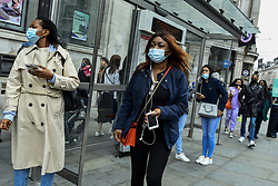 © Licensed to London News Pictures. 26/09/2020. LONDON, UK. Shoppers wearing facemasks at on Regent Street in the West End of the capital.  As the number of coronavirus cases continues to rise heralding a second wave of the pandemic, it is reported that London may soon face more comprehensive lockdown restrictions.  Photo credit: Stephen Chung/LNP