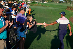 February 28, 2019 - Florida, U.S. - A fan reaches out to touch the hand of Rickie Fowler as he walks past on the 18th hole of the first round of The Honda Classic Thursday, February 28, 2019 at the PGA National Resort & Spa in Palm Beach Gardens. (Credit Image: © Bruce R. Bennett/The Palm Beach Post via ZUMA Wire)