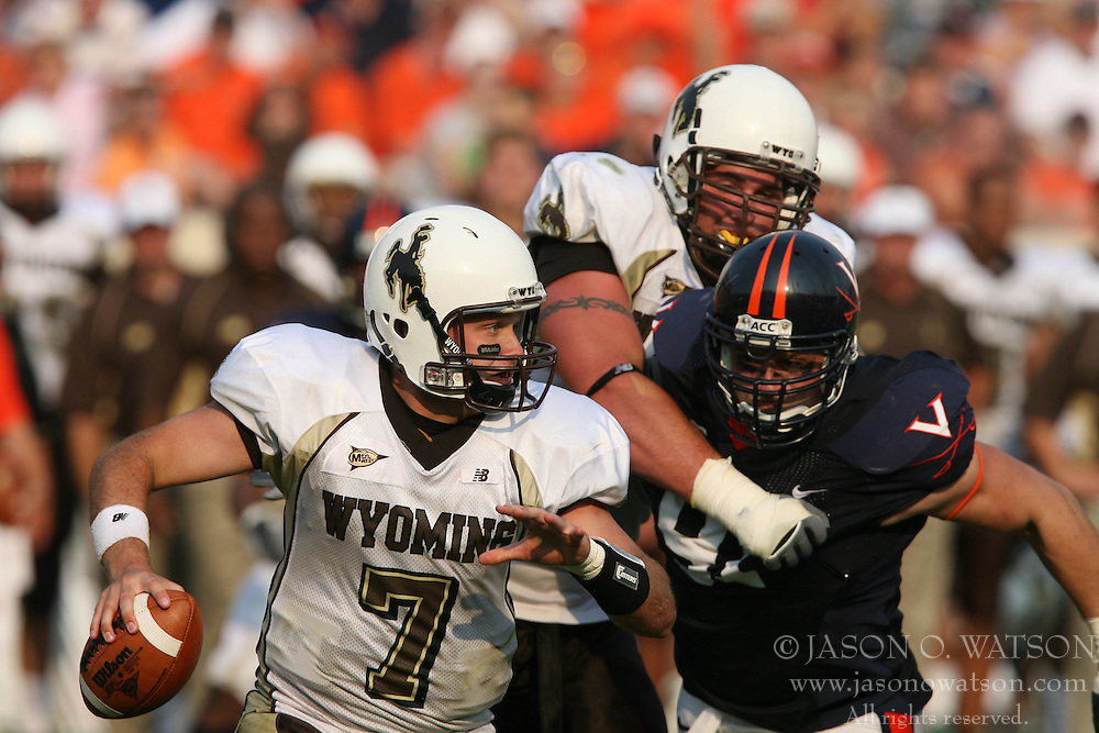 Virginia defensive end Chris Long (91) puts pressure on Wyoming quarterback Jacob Doss (7).  The Virginia Cavaliers defeated the Wyoming Broncos 13-12 in overtime on September 9, 2006 at Scott Stadium in Charlottesville, VA.