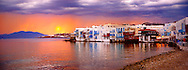 Sunset over The Little Venice (Venetia) neibourhood of the Kastro District of Chora, Mykonos, Cyclades Islands, Greece .<br /> <br /> Visit our GREEK HISTORIC PLACES PHOTO COLLECTIONS for more photos to download or buy as wall art prints https://funkystock.photoshelter.com/gallery-collection/Pictures-Images-of-Greece-Photos-of-Greek-Historic-Landmark-Sites/C0000w6e8OkknEb8