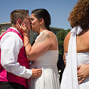 Twenty-five gay couples traveled to Washington on the C-Bus of Love to get married en masse the week before decisions are expected to be made on the Defense of Marriage Act (DOMA) and Proposition 8.