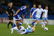 Almen Abdi of Sheffield Wednesday (on ground) is sent flying in a tackle from Lee Peltier of Cardiff city (l).EFL Skybet championship match, Cardiff city v Sheffield Wednesday at the Cardiff city stadium in Cardiff, South Wales on Wednesday 19th October 2016.<br /> pic by Andrew Orchard, Andrew Orchard sports photography.