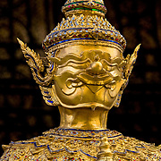 Gold sculpture of mythical guardian creature (Bangkok, Thailand - Oct. 2008) (Image ID: 081012-1126511a)