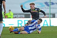 Callum Camps challenged by Michael Jacobs during the EFL Sky Bet League 1 match between Wigan Athletic and Rochdale at the DW Stadium, Wigan, England on 24 February 2018. Picture by Daniel Youngs.