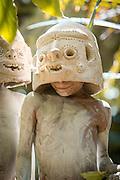 Child of the Kualga tribe of the Olga clan wearing traditional clay masks, Pogla, Mount Hagen, Western Highlands Province, Papua New Guinea