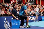 A line umpire doesn't look too impressed that Xavier Malisse decided to use him for a chair during the Champions Tennis match at the Royal Albert Hall, London, United Kingdom on 6 December 2018. Picture by Ian Stephen.