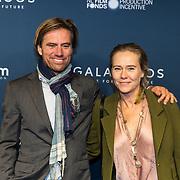 NLD/Amsterdam/20191028 - Koninklijk bezoek Premiere Galapagos, Liesbeth Kamerling en partner Frans Palplatz