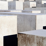 "Holocaust Memorial (Holocaust-Mahnmal) in Berlin. The Memorial to the Murdered Jews of Europe (German: Denkmal für die ermordeten Juden Europas), also known as the Holocaust Memorial (German: Holocaust-Mahnmal), is a memorial in Berlin to the Jewish victims of the Holocaust, designed by architect Peter Eisenman and engineer Buro Happold. It consists of a 19,000 square meter (4.7 acre) site covered with 2,711 concrete slabs or ""stelae"", arranged in a grid pattern on a sloping field. The stelae are 2.38m (7.8') long, 0.95m (3' 1.5"") wide and vary in height from 0.2 m to 4.8m (8"" to 15'9""). According to Eisenman's project text, the stelae are designed to produce an uneasy, confusing atmosphere, and the whole sculpture aims to represent a supposedly ordered system that has lost touch with human reason. A 2005 copy of the Foundation for the Memorial's official English tourist pamphlet, however, states that the design represents a radical approach to the traditional concept of a memorial, partly because Eisenman did not use any symbolism. An attached underground ""Place of Information"" (German: Ort der Information) holds the names of all known Jewish Holocaust victims, obtained from the Israeli museum Yad Vashem...Building began on April 1, 2003 and was finished on December 15, 2004. It was inaugurated on May 10, 2005, sixty years after the end of World War II, and opened to the public on May 12 of the same year. It is located one block south of the Brandenburg Gate, in the Friedrichstadt neighborhood. The cost of construction was approximately EUR25 million."