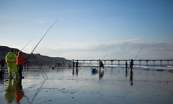 © Licensed to London News Pictures. <br /> 12/10/2014. <br /> <br /> Saltburn, United Kingdom<br /> <br /> Over 70 fishermen take part in the annual Jim Maidens memorial beach fishing competition in Saltburn by the Sea in Cleveland. <br /> The competition is held each year to mark the death of Saltburn plumber and keen fisherman Jim Maidens who died in 1998 when he was killed after being swept overboard from his boat 'Corina' close to the beach at Saltburn.<br /> <br /> Photo credit : Ian Forsyth/LNP