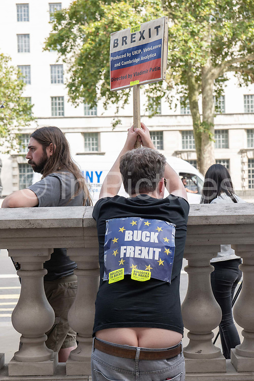 Amale anti-Brexit campaigner, revealing his bum crack, outside the Cabinet Office on Whitehall on the 29th August 2019 in London in the United Kingdom. A group gather outside the Cabinet Office, protesting against British Prime Minster Boris Johnson's announcement of a suspension of Parliament.