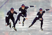 The U.S. Men's Team Pursuit Speed Skating team (from left to right) K.C. Boutiette (#1), Clay Mull (#4) and Charles Ryan Leveille Cox (#3) fires off the starting line in the C Finals at the Oval Lingotto in Turin, Italy on Thursday February 16, 2006. The U.S. men finished 6th in the event and the U.S. women finished 5th..(Photo by Marc Piscotty / © 2006)