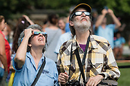 Middletown, New York - People using eclipse glasses gather on Alumni Green at SUNY Orange to watch a partial solar eclipse on Aug. 21, 2017.