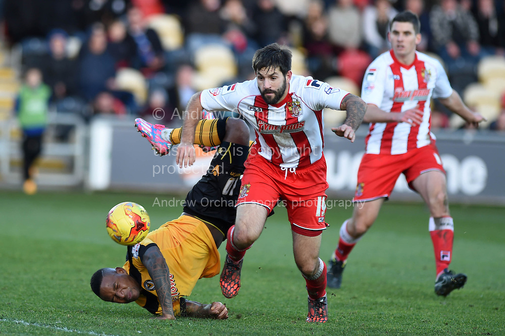 Newport county's Aaron O'Connor falls awkwardly as he tumbles over Dean Wells of Stevenage. Skybet football league two match, Newport county v Stevenage at Rodney Parade in Newport, South Wales on Saturday 13th December 2014<br /> pic by Andrew Orchard, Andrew Orchard sports photography.
