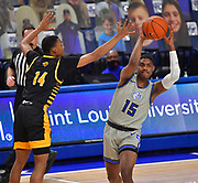 St Louis Billikens guard Demarius Jacobs (15, right) passes as he is pressured by Arkansas-Pine Bluff Golden Lions guard George Ivory III (14). St. Louis University hosted the University of Arkansas - Pine Bluff in a mens basketball game on December 5, 2020 at Chaifetz Arena on the SLU campus in St. Louis, MO.<br /> Photo by Tim Vizer