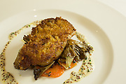 New York, NY - 27 May 2014. Sweetbreads with carrots, pearl onions, mushrooms, and a coarse grain mustard beurre blanc at The Simone.