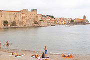 The beach in the village. The chateau in Collioure harbour. Collioure. Roussillon. France. Europe.