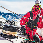 Leg 7 from Auckland to Itajai, day 10 on board MAPFRE, Tamara Echegoyen managing the ropes with a masive wave behind, 27 March, 2018.