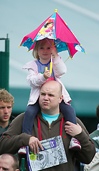 22.06.2011, Wimbledon, London, GBR, Wimbledon Tennis Championships, im Bild A young child sheilds from the rain during the Ladies' Singles 1st Round match on day three of the Wimbledon Lawn Tennis Championships at the All England Lawn Tennis and Croquet Club, EXPA Pictures © 2011, PhotoCredit: EXPA/ Propaganda/ *** ATTENTION *** UK OUT!