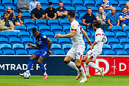 Cardiff City midfielder Leandro Bacuna  (7) crosses the ball with Bournemouth midfielder Ben Pearson (22) nearby during the EFL Sky Bet Championship match between Cardiff City and Bournemouth at the Cardiff City Stadium, Cardiff, Wales on 18 September 2021.