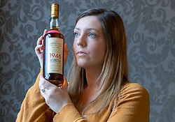 Auction house, Bonham's, will be holding a sale of rare whisky on 7 March 2018 at 11am. <br /> <br /> The sale includes two rare whiskies; a bottle of the Macallan Select Reserve 52 year-old 1946, bottled in May 1998. It is estimated at £12,000-14,000 and a bottle of Black Bowmore 1964, bottled in 1994, and estimated at £8,000-10,000. <br /> <br /> The 1946 Macallan was produced in an unusual way. Coal was scarce and expensive immediate after World War II, so the malt was dried in peat-fired kilns instead resulting in a whisky with distinct and complex tastes and aromas.<br /> <br /> Pictured: Bethan Koller of Bonhams with the Macallan 1946