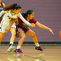 Photo: Jeffery Jones<br /> <br /> Shiprock Lady Chieftain Lisa Begay (30) and Miyamura Lady Patriot Haila Dennison (10) chase a loose ball Thursday night at Miyamura High School in Gallup. The Lady Chieftains won 49-36.