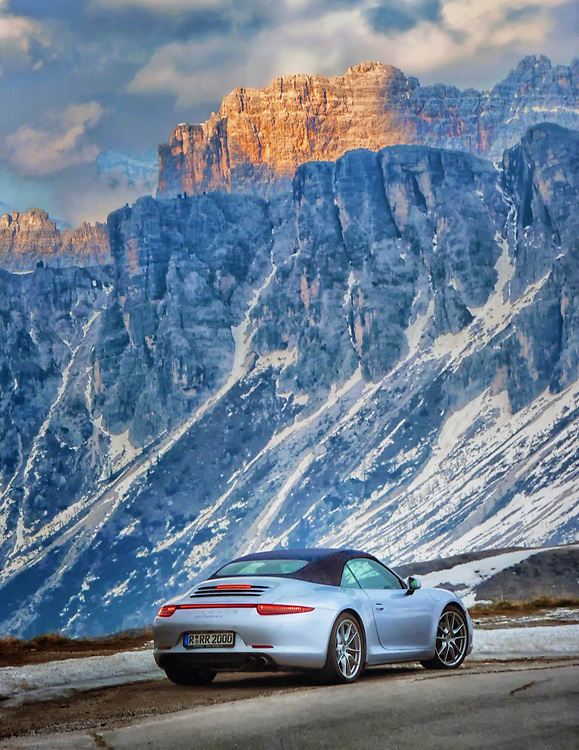 Porsche 911 Cabriolet in the late afternoon on Passo Giao in the Dolomites of the Italian Alps.